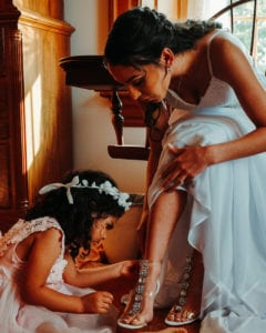 Bride getting ready by Topher Sean Photography